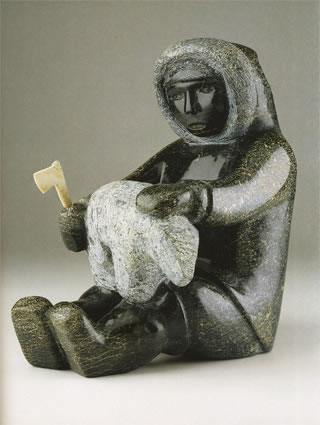 OVILOO TUNNILLIE MY FATHER CARVING A BEAR, 2004 Serpentine, Antler H14 x W12 x D9 in © Spirit Wrestler Gallery