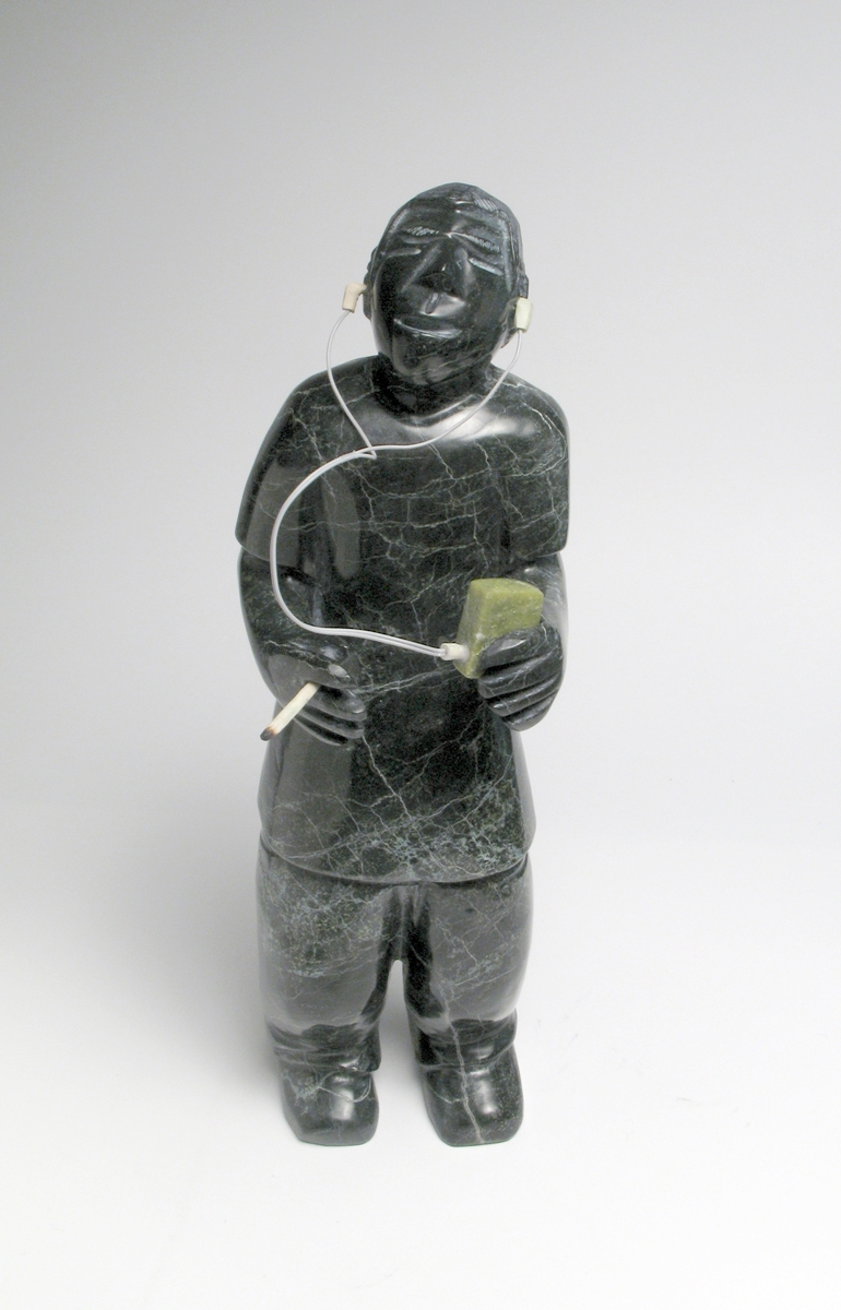 PITSEOLAK QIMIRPIK  YOUING MAN WITH MP3 PLAYER, 2010  Serpentine, Antler and Wire  H17 x W4.5 x D3.4 in