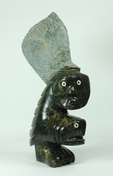 "Ningeosiaq Ashoona  6092A Spirits, 2006    serpentinite, ivory    h 21.5"" w 14"" d 4.5"""
