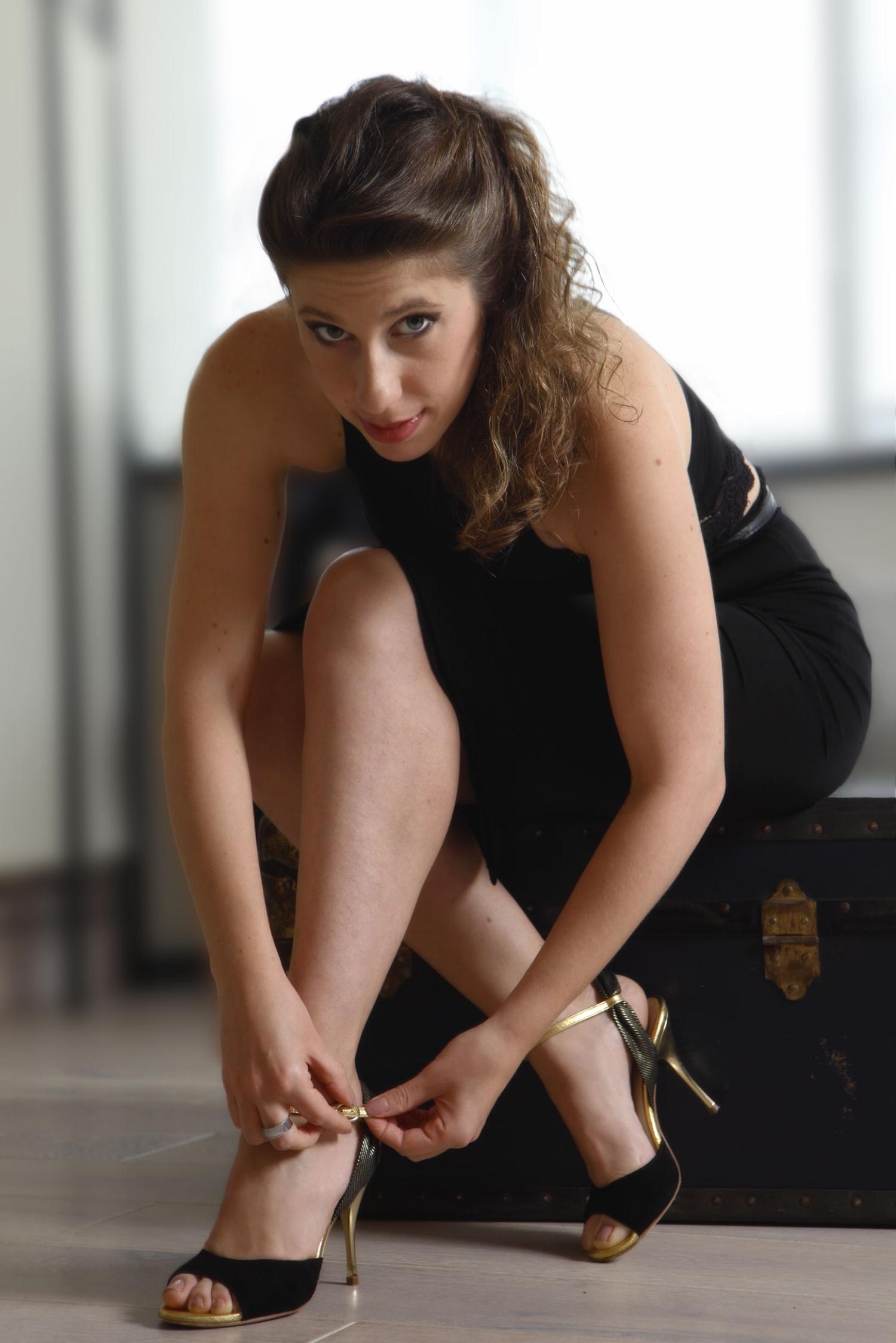 Stefania Colina putting on shoes (Al Verla Pasar) - click to shop