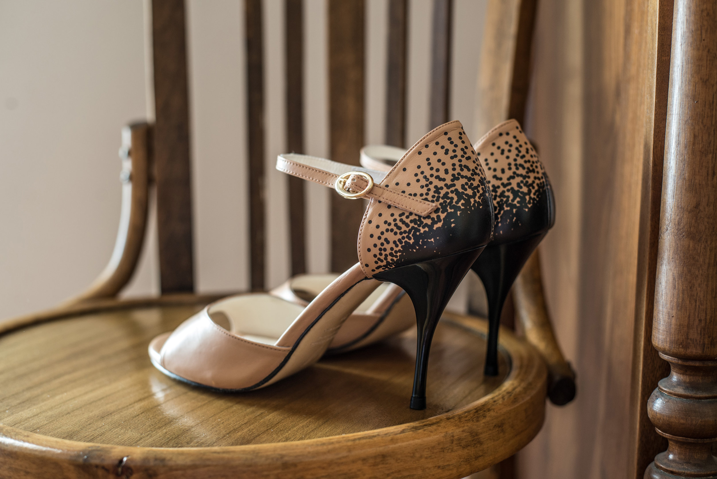 Click to shop Suerte Loca nude black spots tango shoes