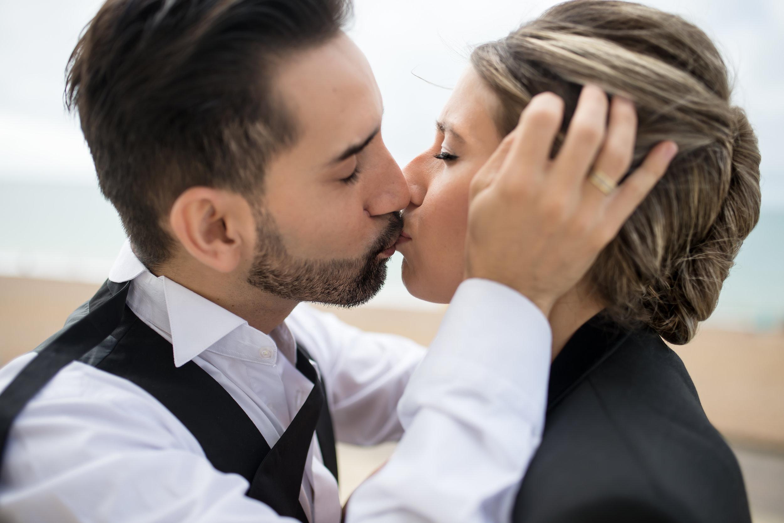 Stefania and Juan kiss