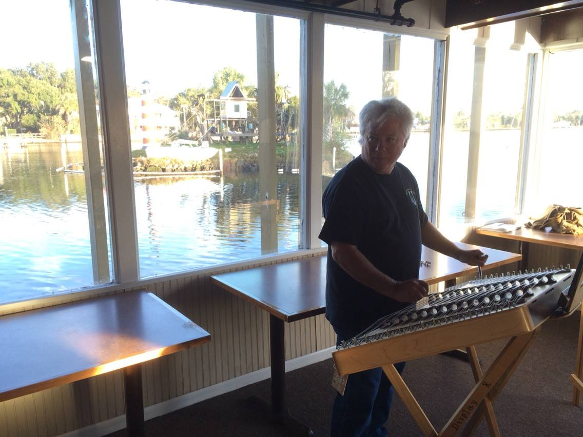 Guy George prepares to teach a hammered dulcimer workshop with Monkey Island in the background.