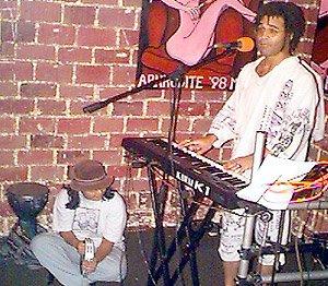 Performing on a Kawai K-1 at Java Jabbers in Orlando, Florida circa 1998. Monica Rabino is playing tambourine.