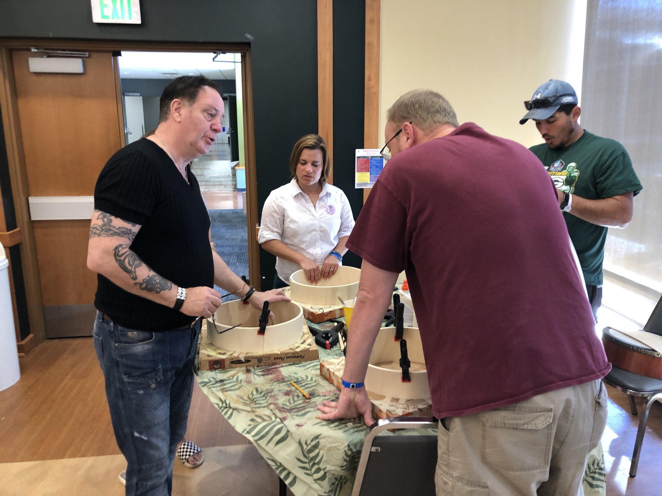 Frank McGuire teaching students how to make a bodhran at Common Ground On The Hill week 3.
