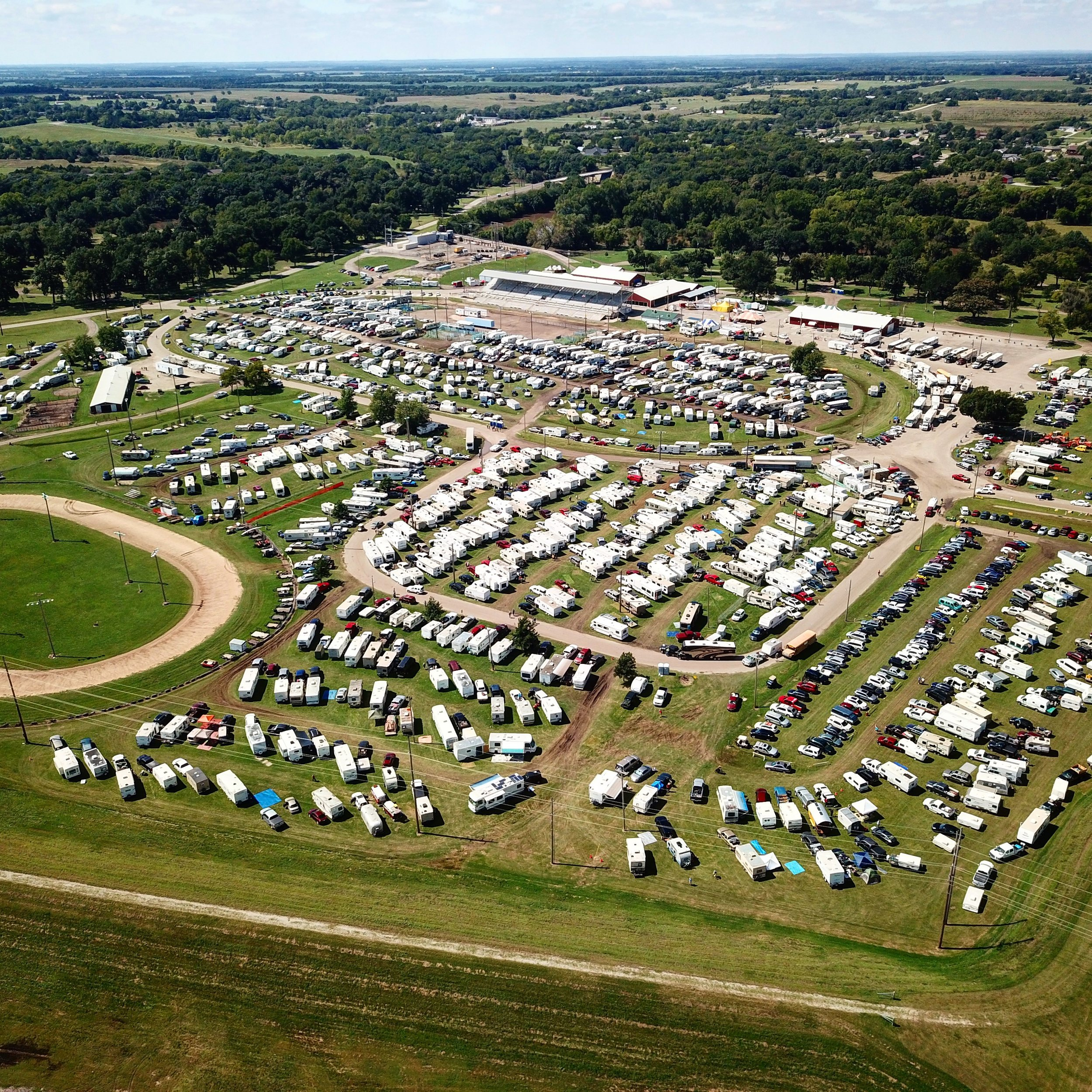 Winfield Fairgrounds On The day of Land Rush. Those are all campers waiting to enter the two campgrounds (the tree-lined groves at the top of the picture.) I used my DJI Mavic Pro to get this shot off festival grounds.