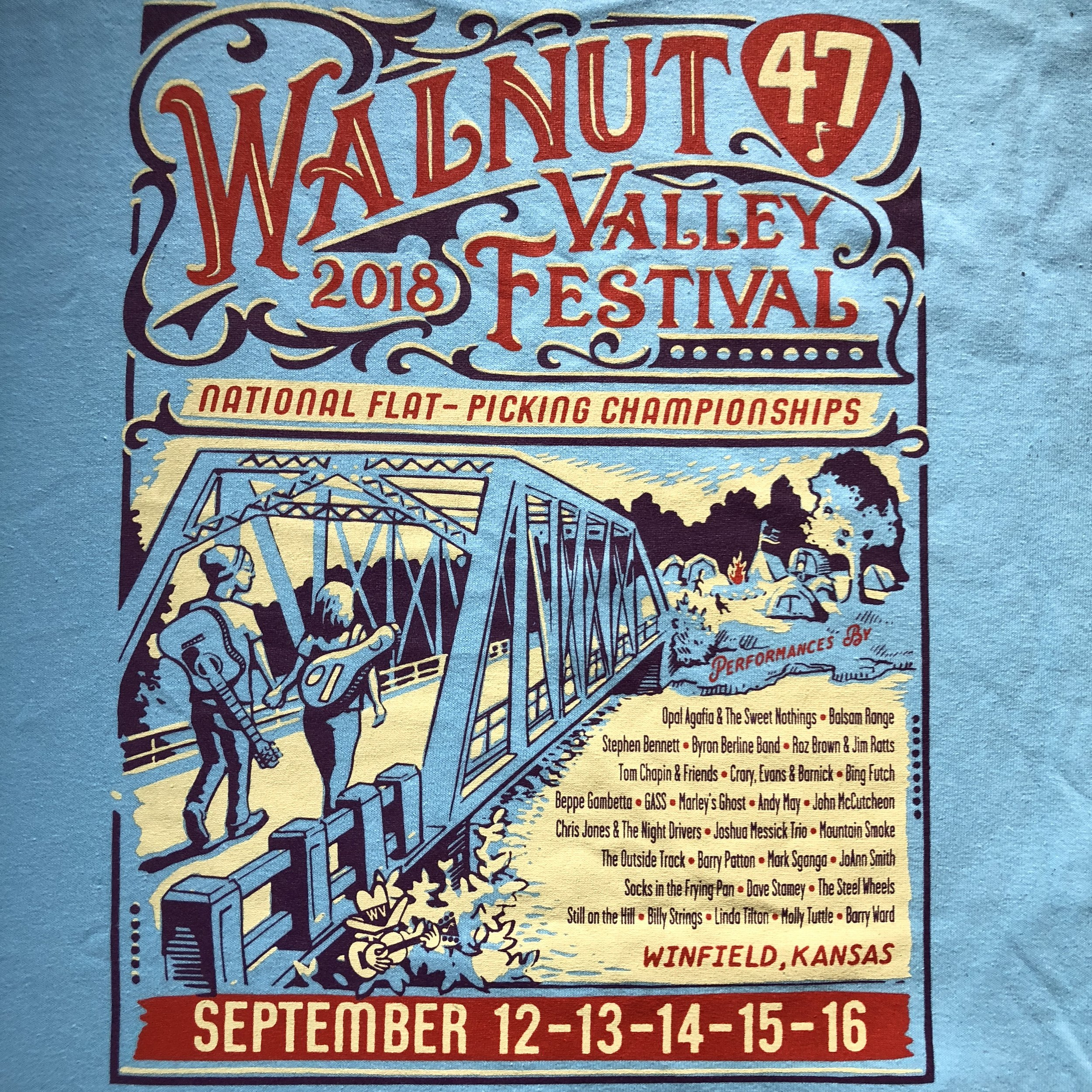 This year's official t-shirt with all of the featured acts on the back.