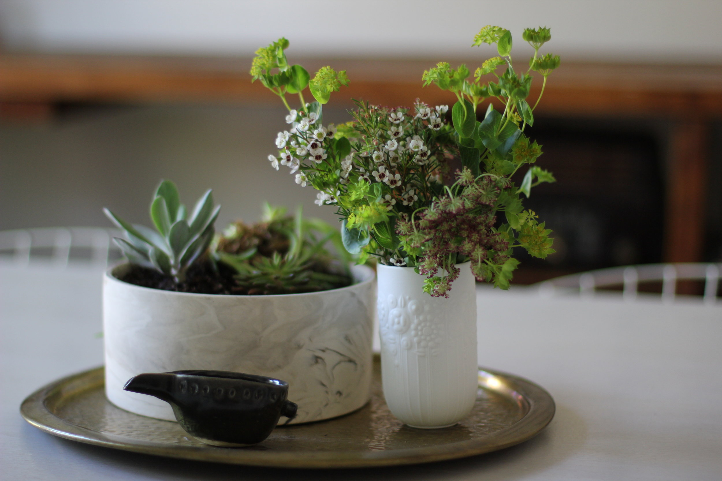 pot of succulents and wildflowers in vases