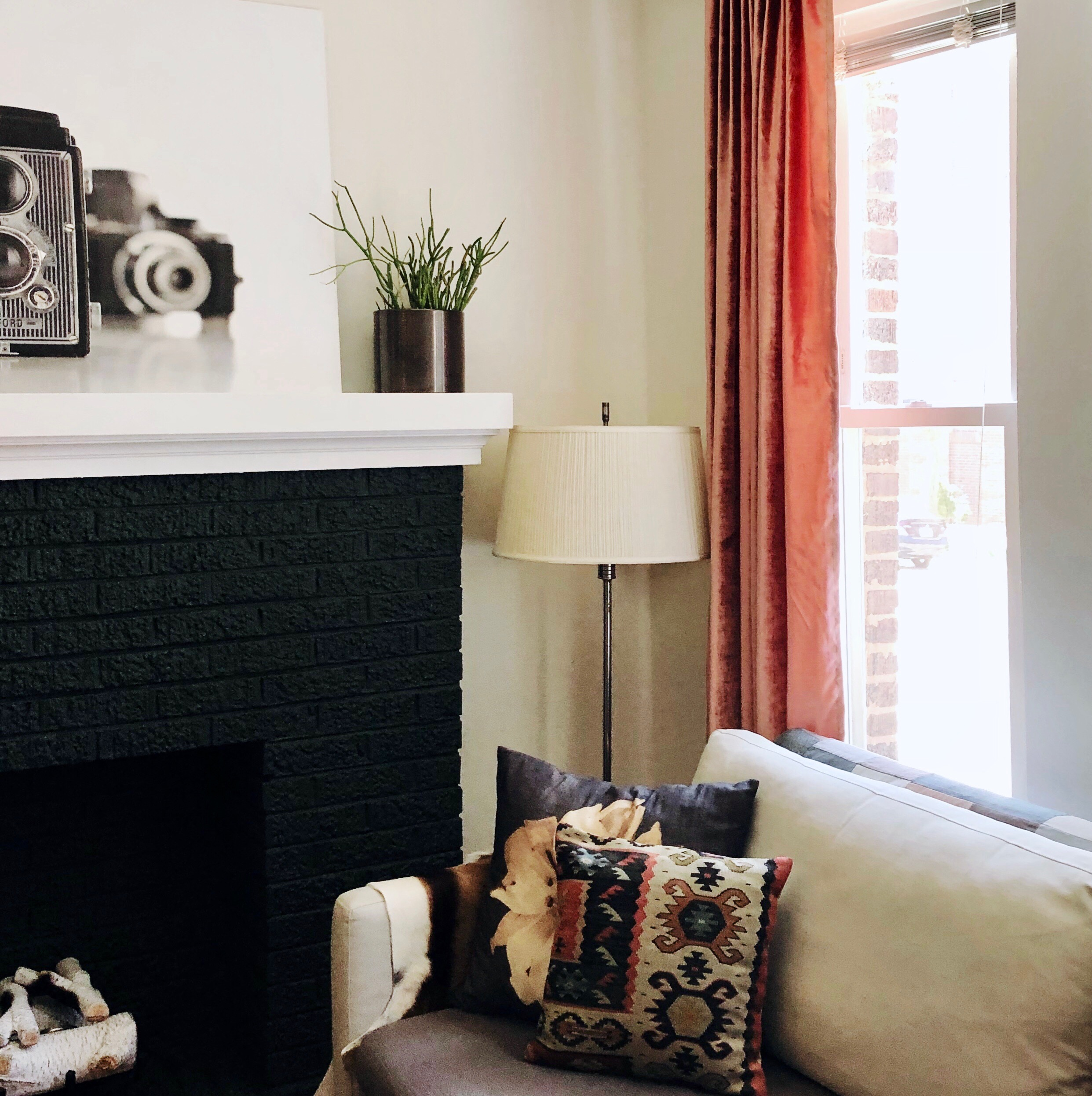 painted fireplace and sofa in living room