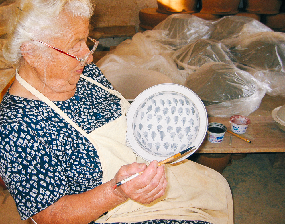 Katerina Lembesis is 86 years old and has been decorating pottery since 1950, alongside her husband, father and now grandsons. Her designs are inspired by the land and sea—the things she knows and loves best.
