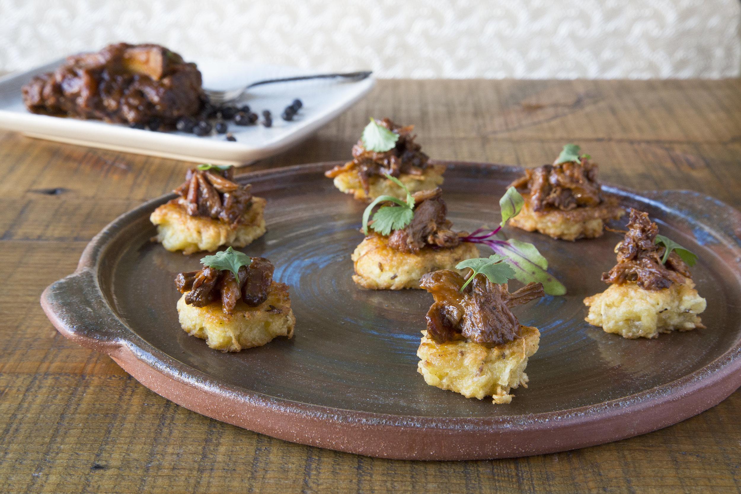 Juniper Berry Braised Oxtail w/cassava cake & micro cilantro