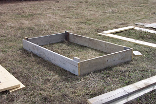 The first bed (from recycled lumber) is put together.