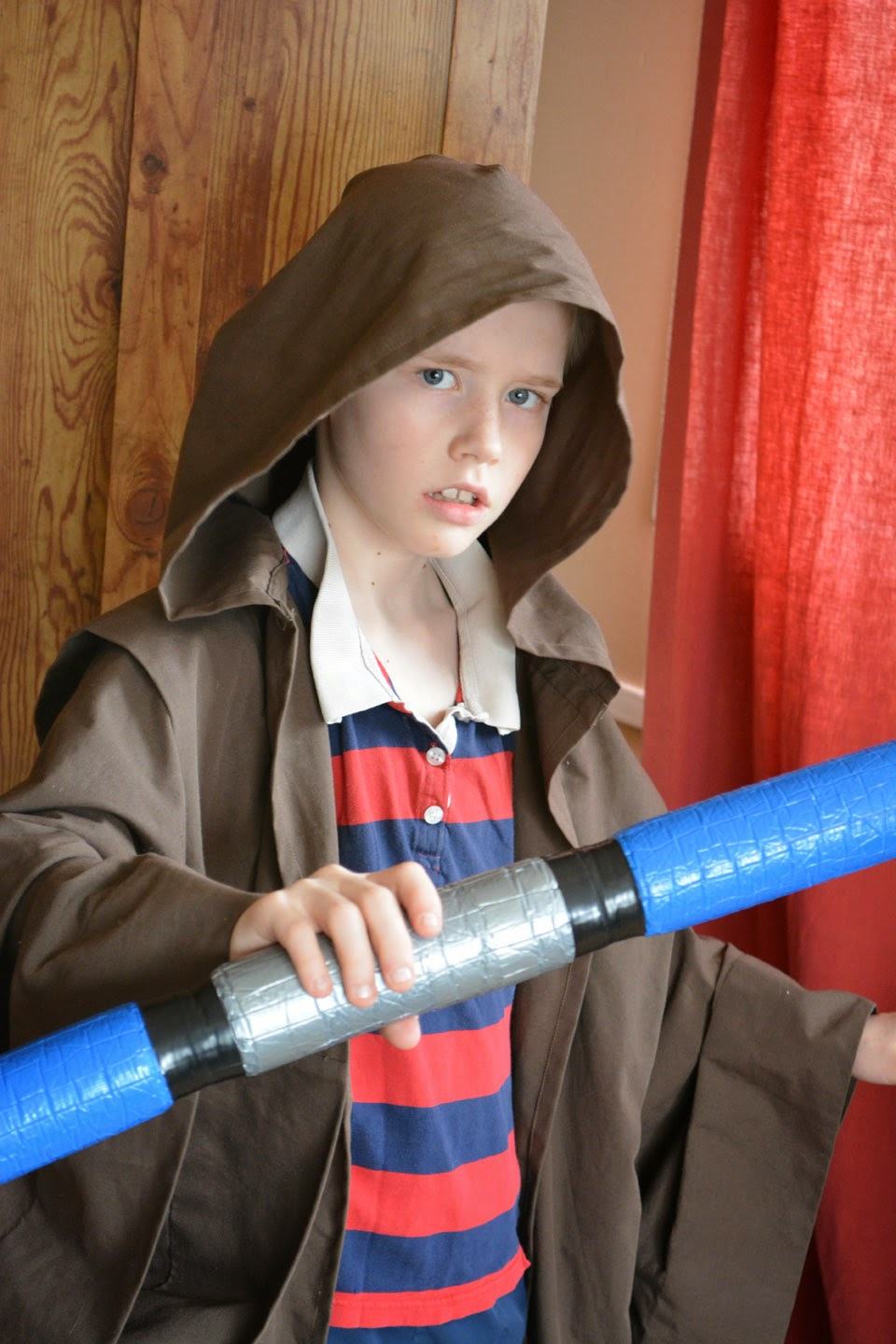 Jedi boy with light sabre