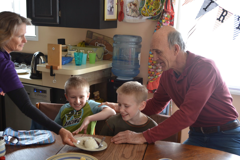 Grandpa Mike can't help but tease the boys. Grandma Laurel helps me serve dessert.