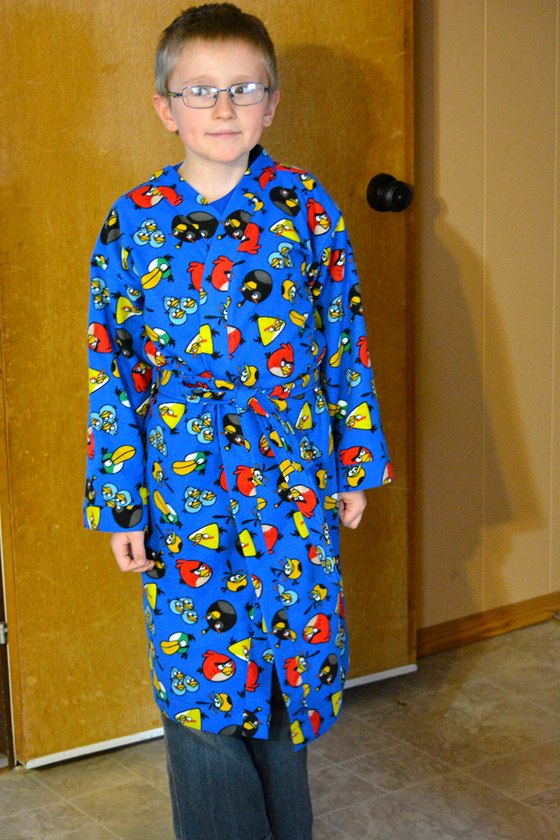 Jabin showing off his new Angry Birds flannel robe that I made him on the weekend as a birthday present.