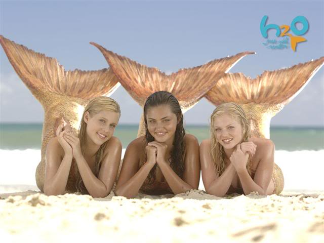 Claire Holt, Phoebe Tonkin, and Cariba Heine as the three original mermaids of   H2O: Just Add Water (2006-2010)  .