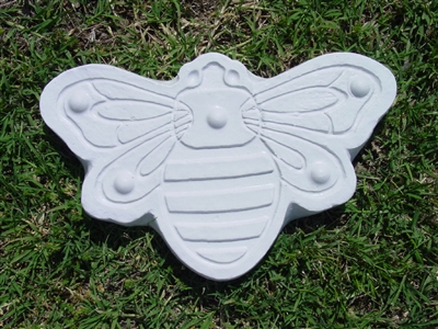 I've been wanting to make these, or a hexagonal-shaped honeycomb stepping stone path. This  cement honeybee mold is from MoldCreations.com .