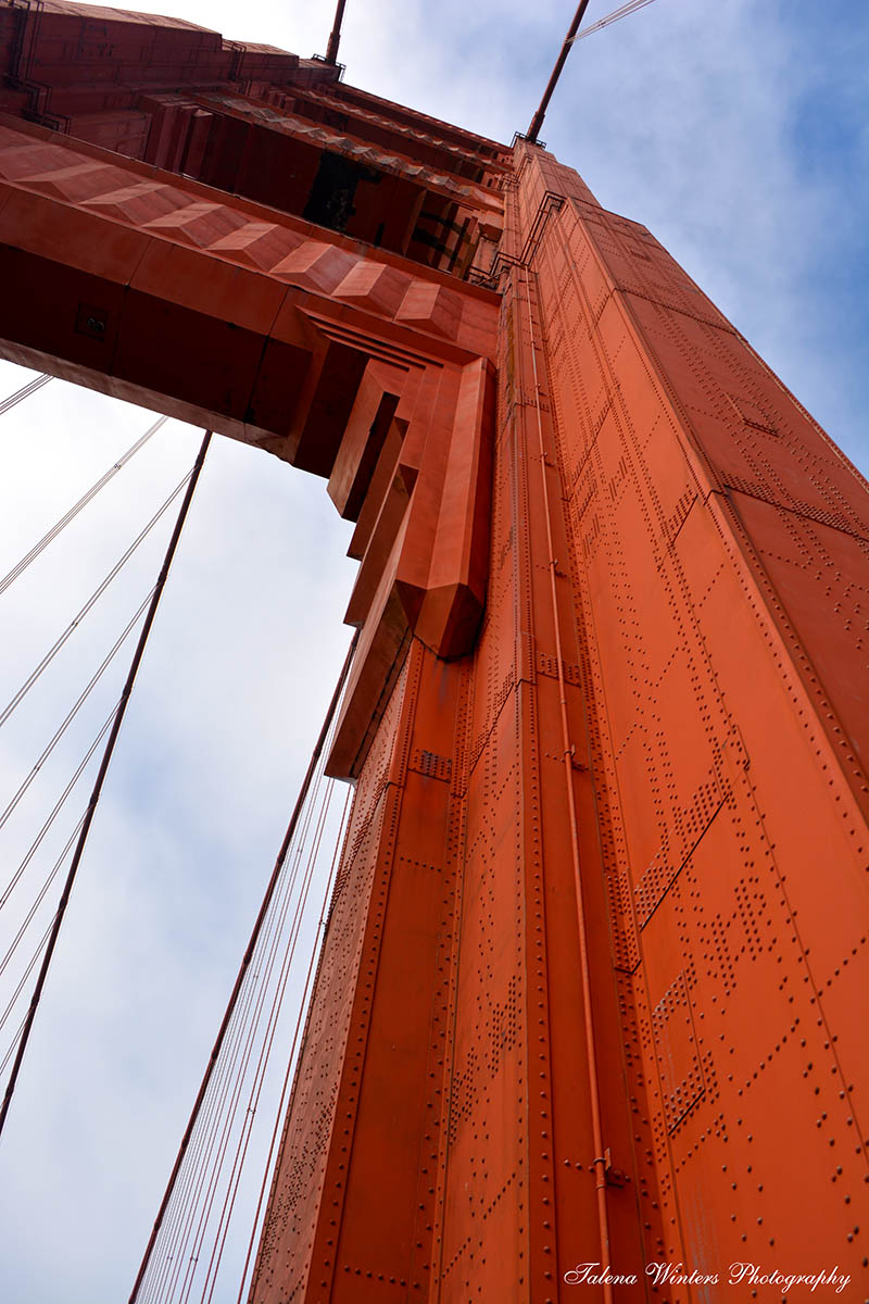 Under an arch of the Golden Gate Bridge. (The bridge's name refers to the Bay, the final resting place of scores of ships that transported many hopeful millionaires during the gold rush that took San Francisco from a settlement of 300 to a city of 20,000 in 1849. Which is why it's not actually gold.)