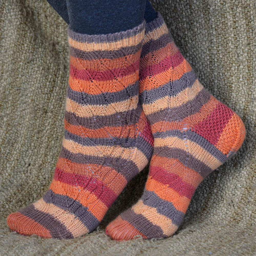 Knitting pattern - Jill and the Bean Socks - with cable; pretty mirrored twists up the leg. My Secret Wish by Talena