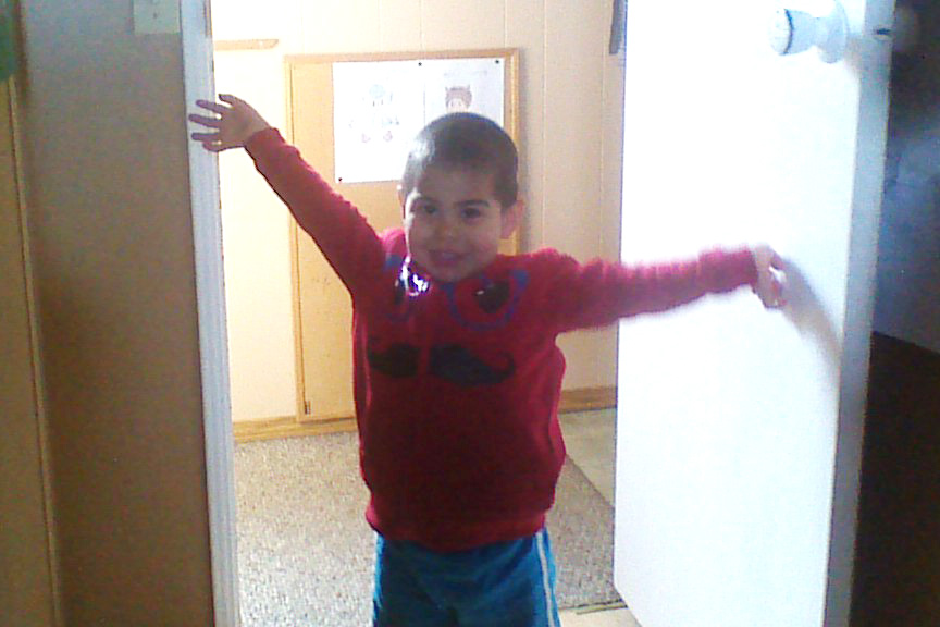 Levi shows off a new sweater he got for his 3rd birthday. Photo taken 2015/04/27.