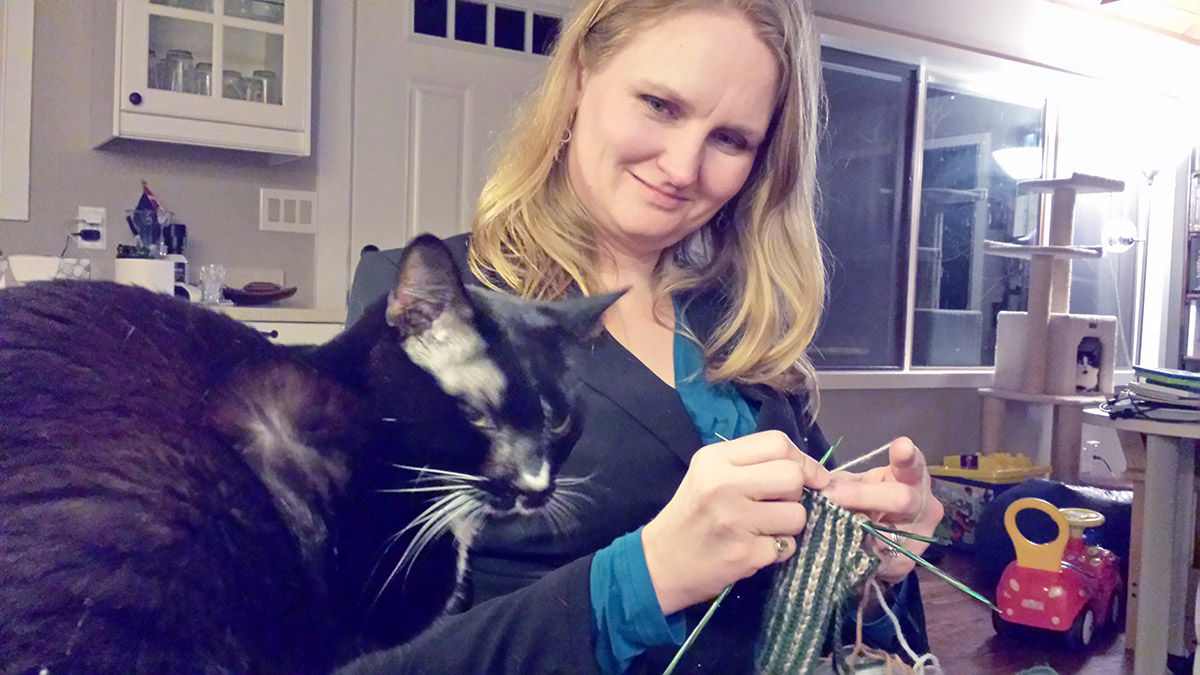 "TC ponders whether to ""help"" with the knitting."