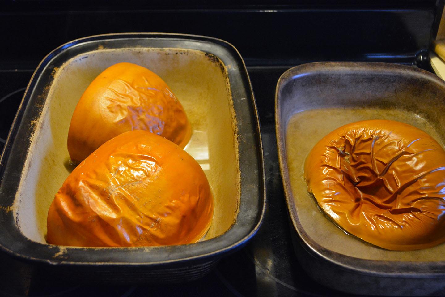 Pumpkin after it has been cooked. The skin has blistered somewhat and the most cooked one has deflated.