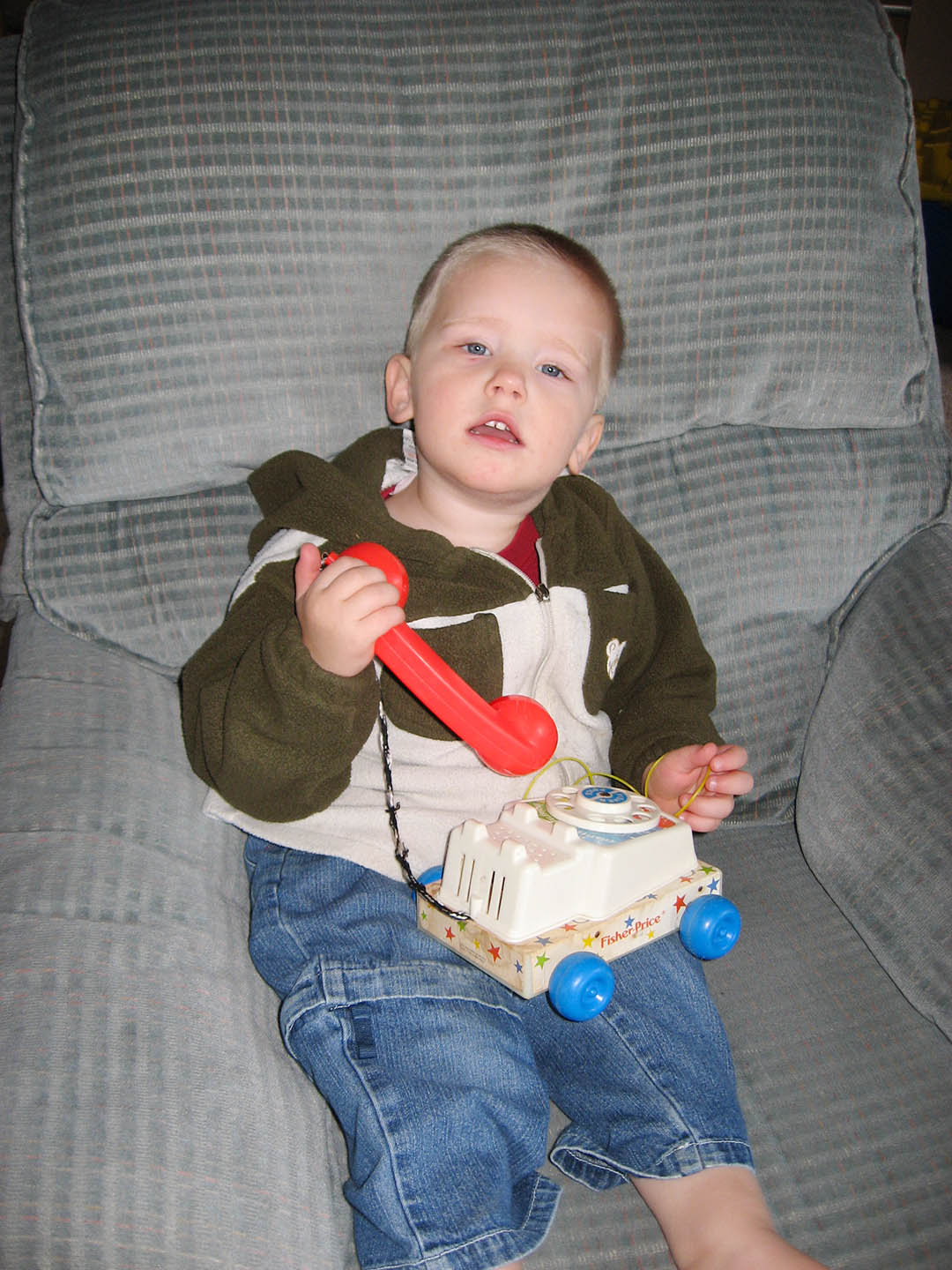 Noah and his current favourite toy--an old Fisher-Price phone.