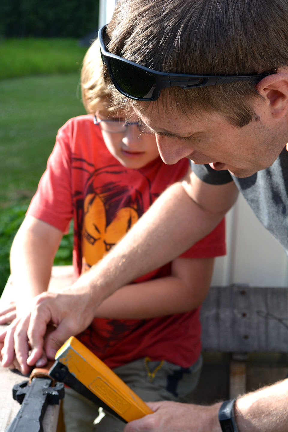 Father-son craft time: Jason helped the boys (and a few other kids, too) make their own wooden swords this summer, complete with leather-wrapped handles.