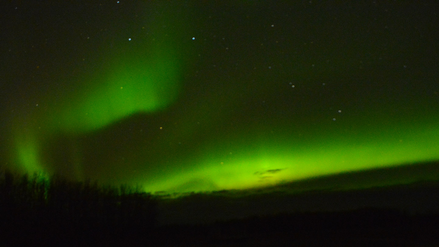 A stunning display of Northern Lights on an only mildly-chilly evening with a camera handy and some time to experiment resulted in this photo. It was pretty fun.