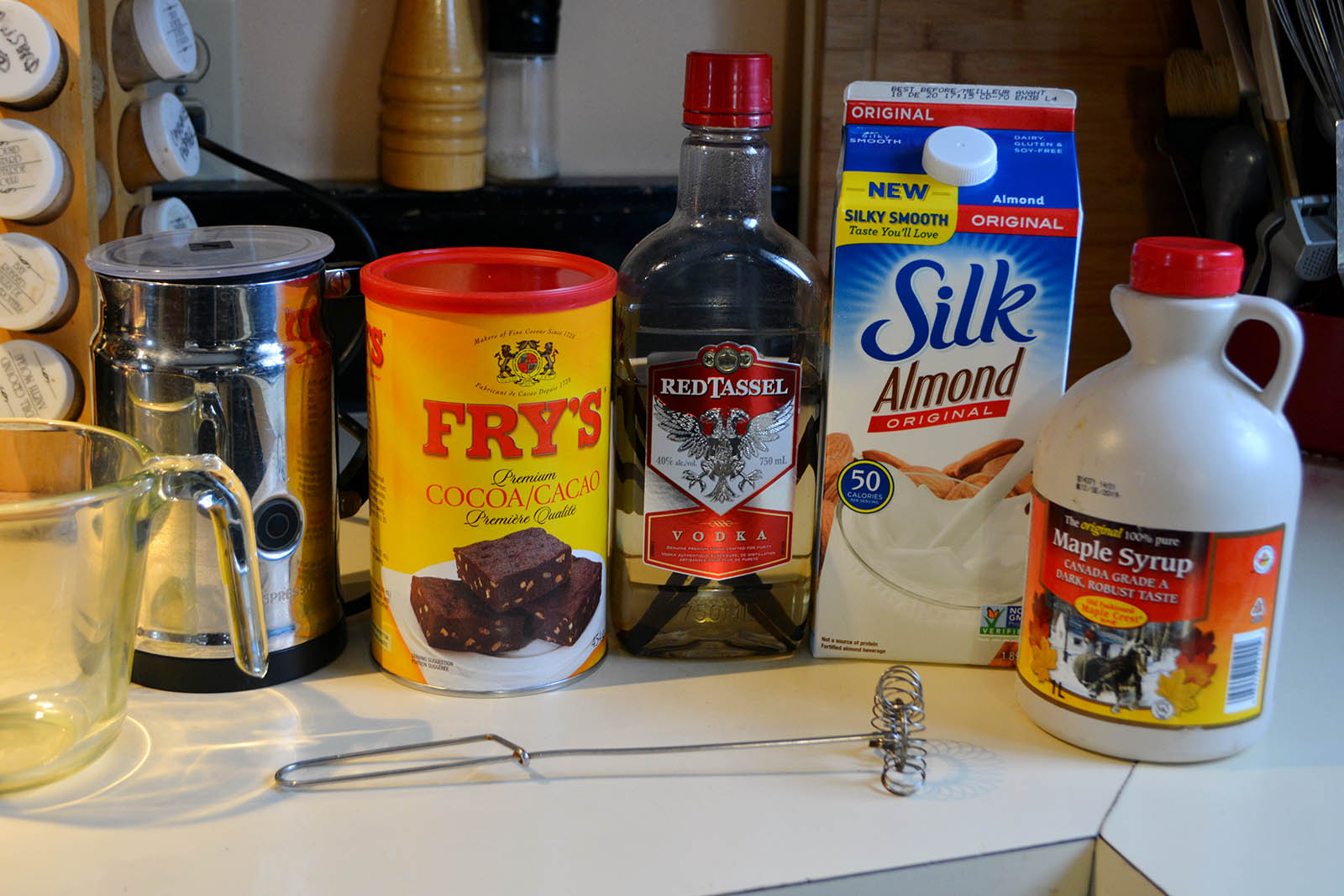 Ingredients for Dairy-Free Hot Chocolate. The vodka bottle is actually homemade vanilla.