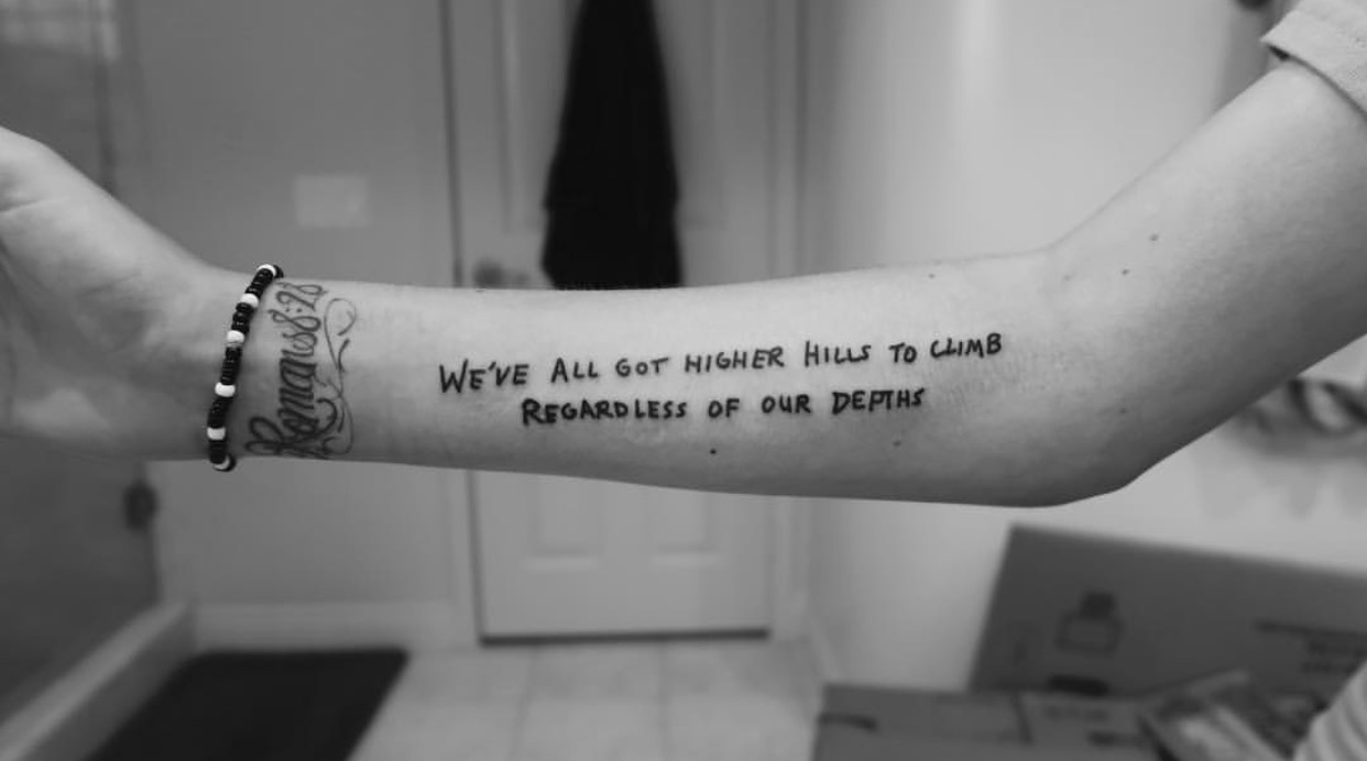 higher hills to climb. wrote this tattoo out for Zoey Borrelli.  California.