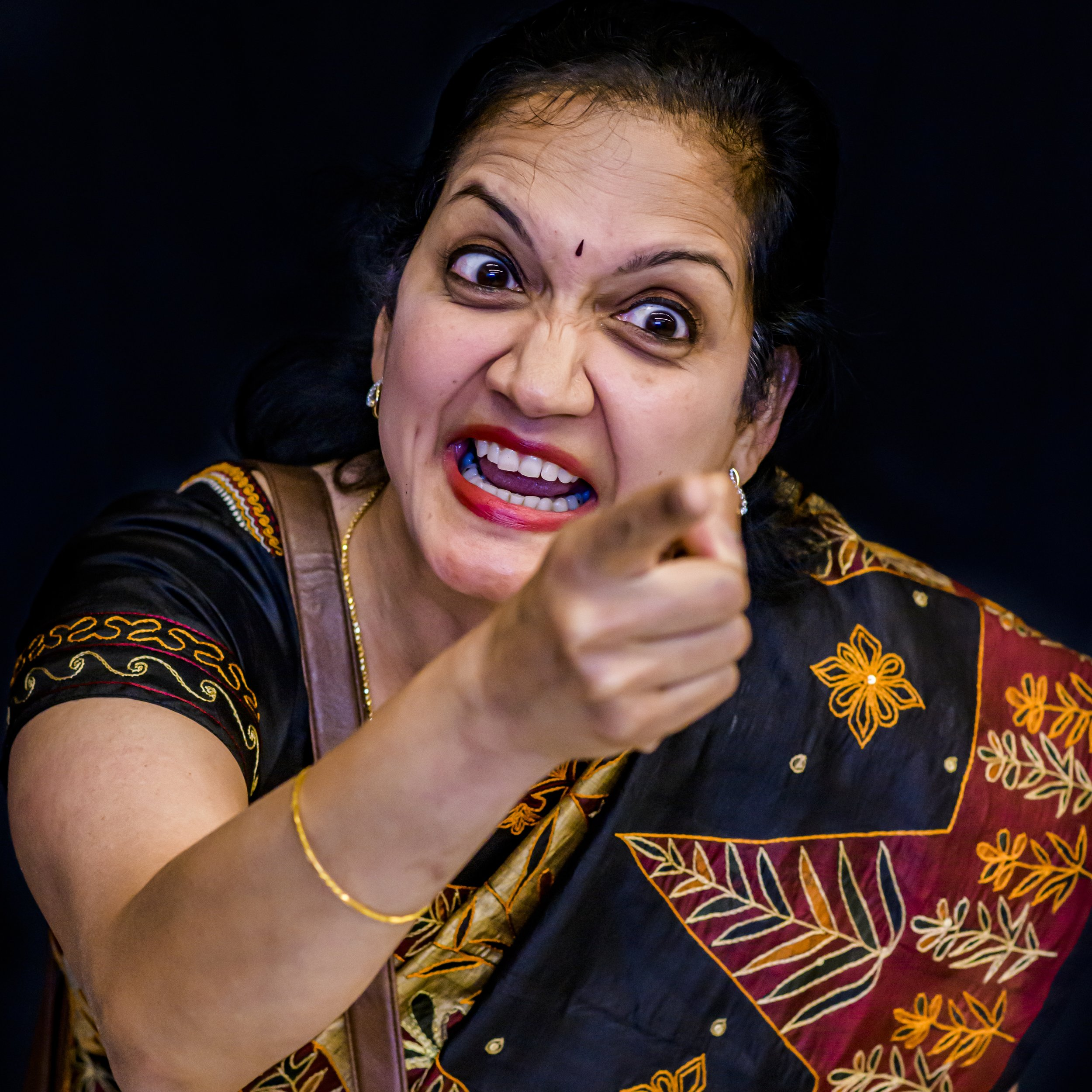 """Saroja - The Firebrand. Has no qualms about """"borrowing"""" the neighbour's maid. But god help us if she is at the receiving end!Played by Anju Prakash."""