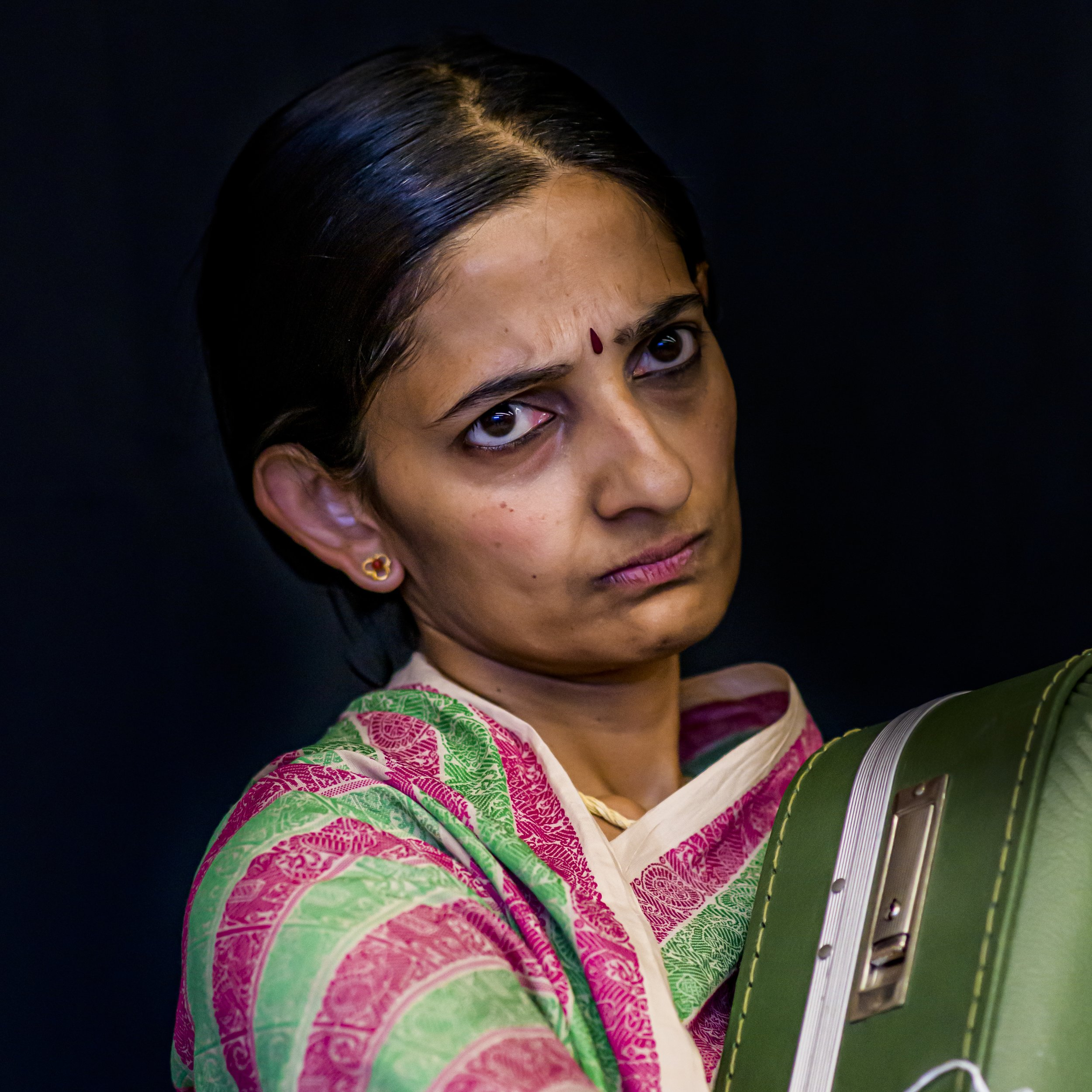 Sumitra - The Whiner. Doesn't want to go back to the village. Looks the gift horse straight in the mouth. Was she right?Played by Malavika Jayasimha