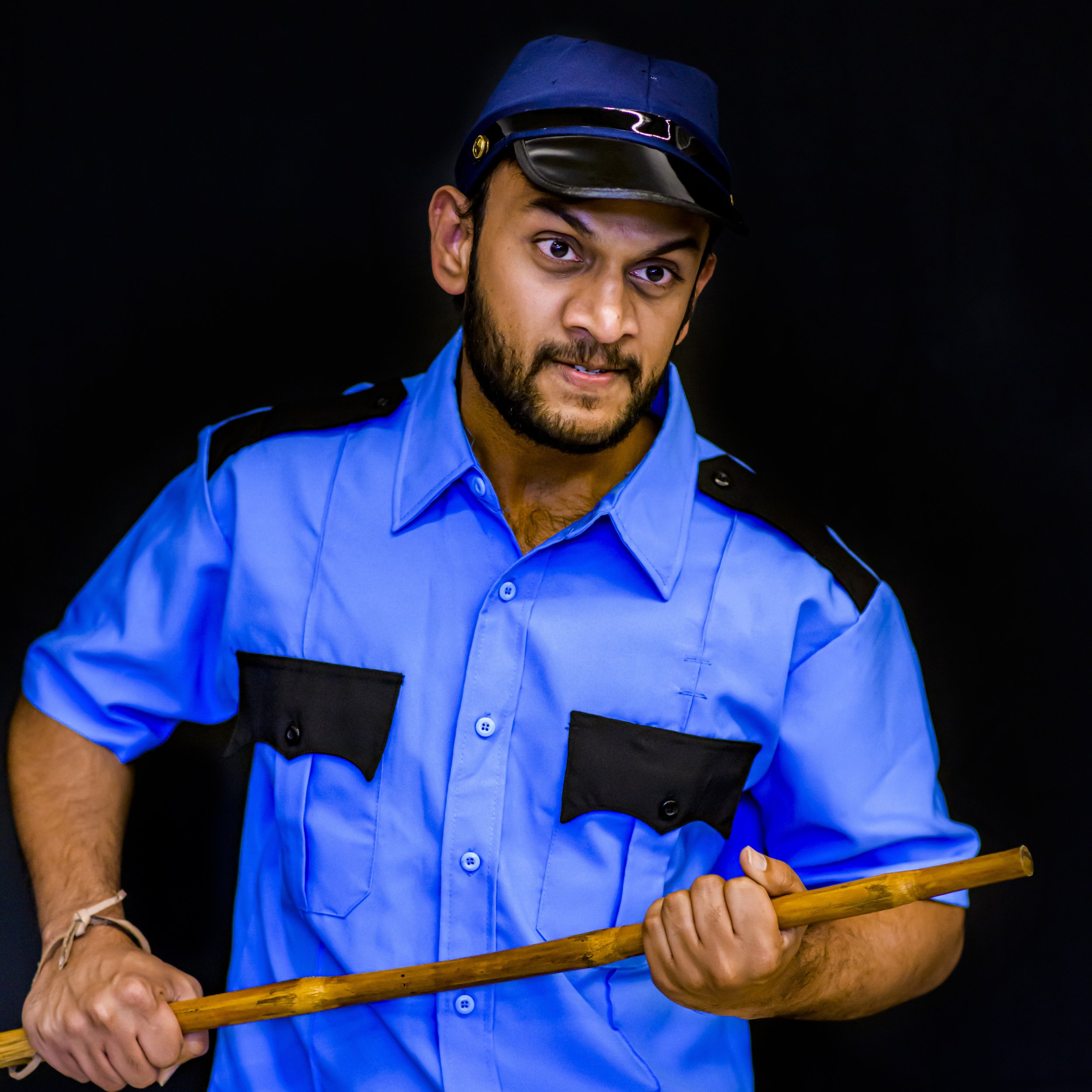 Guard - Protector of Wipro. Actually, just Wipro, Sarjapur campus, Building 23A, lobby.Played by Abhinay Rao