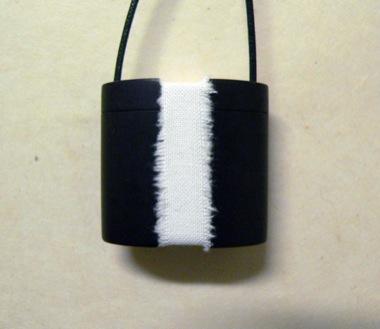 JAMES MCALLISTER (GUEST ARTIST)    Black Box (Cont. 3 Dice)    2009   Black bakelite/bone/closure   40 x 38 mm
