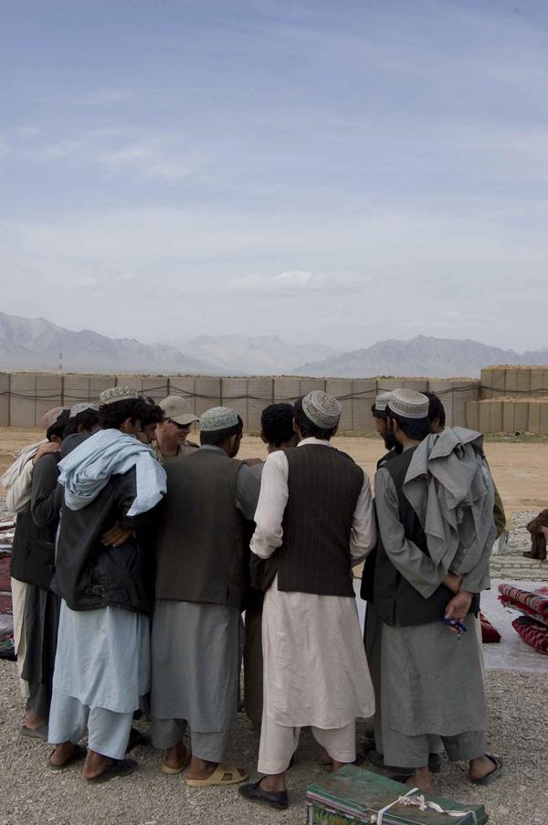 LYNDELL BROWN CHARLES GREEN     Afghan Traders with Soldiers, Market, Tarin Kowt Base, Uruzgan Province, Afghanistan  2007-08 Digital colour photographs, inkjet prints on rag paper, unframed 155 x 107.5 cm