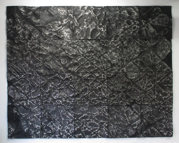 Catherine Woo,  Interface,  2016, 20 panels of thin black coated aluminium, pressed and rubbed onto a geographic formation, 240 x 300 cm.