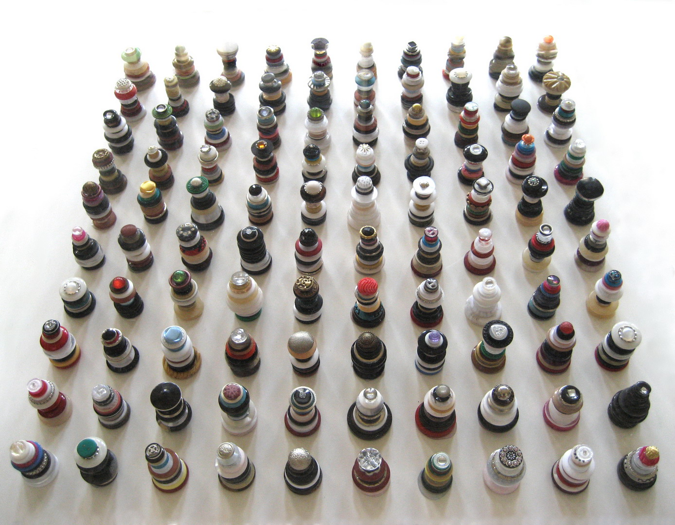 One hundred Pagodas , 2014, Buttons, perspex, 60 x 60 cm