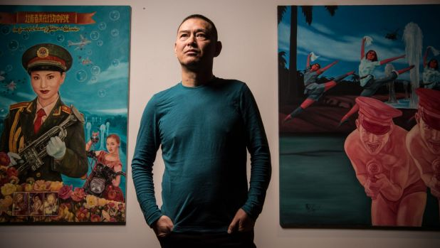 Image: Guo Jian with his works installed in  Refugees . Photo: Wolter Peeters.