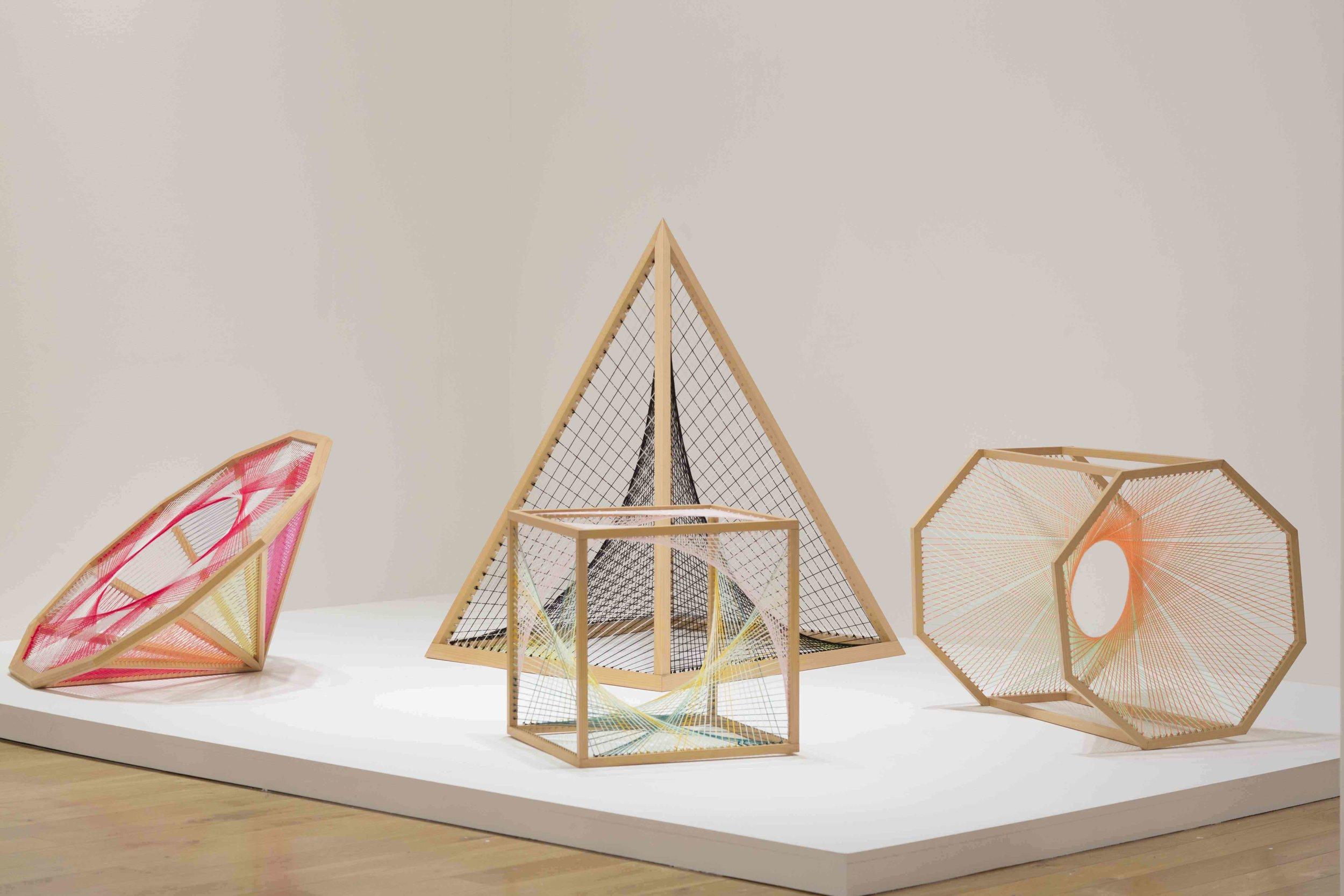 NIKE SAVVAS   Sliding Ladder: Dihexagonal #1,Sliding Ladder: Pyramid #2,Sliding ladder: Cube #1,Sliding ladder: Octagonal Prism #1  2010 Wood, wool, steel Dimensions variable