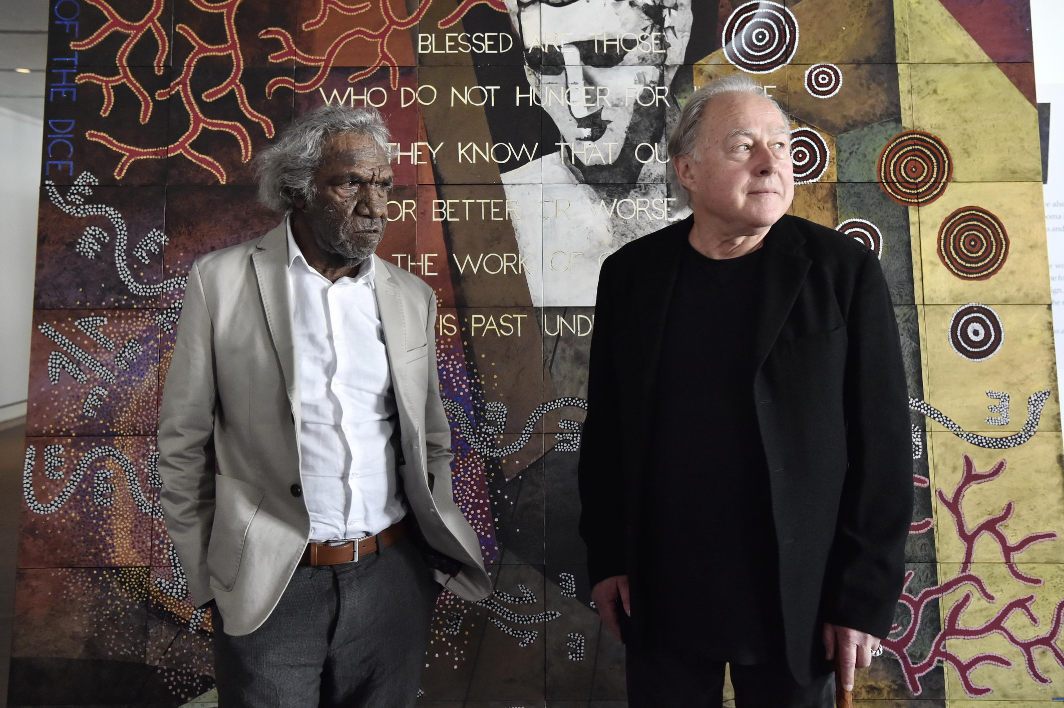 Image: Michael Nelson Jagamara and Imants Tillers unveiling  The Messenger  at Parliament House, Canberra. Photographs: DPS/Auspic.