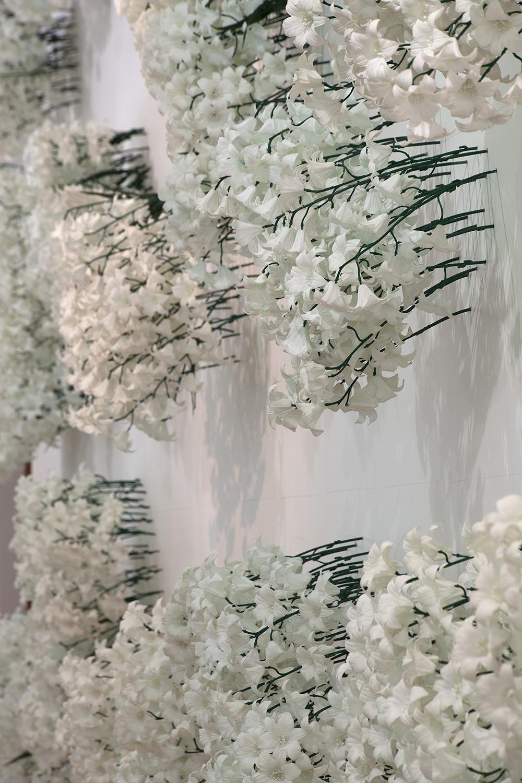 MARIA FERNANDA CARDOSO   Cemetery, vertical garden  (Install View) 1992 Plastic flowers, pencil on wall Dimensions variable
