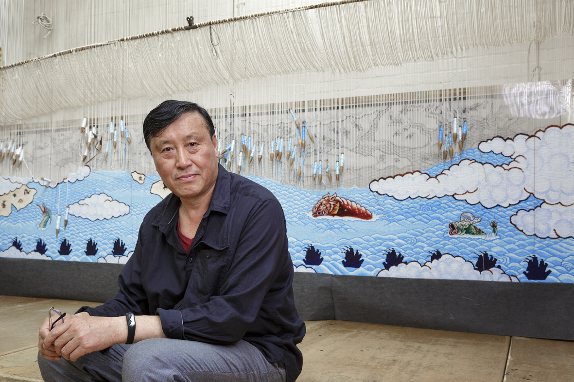 Portrait of Guan Wei at The Australian Tapestry Workshop