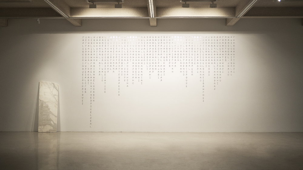 in a word untitled #1,  2004, marble, 193.5 x 71.5 x 3 cm;  Un(truth),  2019, reflective vinyl, 578 x 358.5 cm. Installation view at Campbelltown Arts Centre; photo courtesy of the C-A-C.