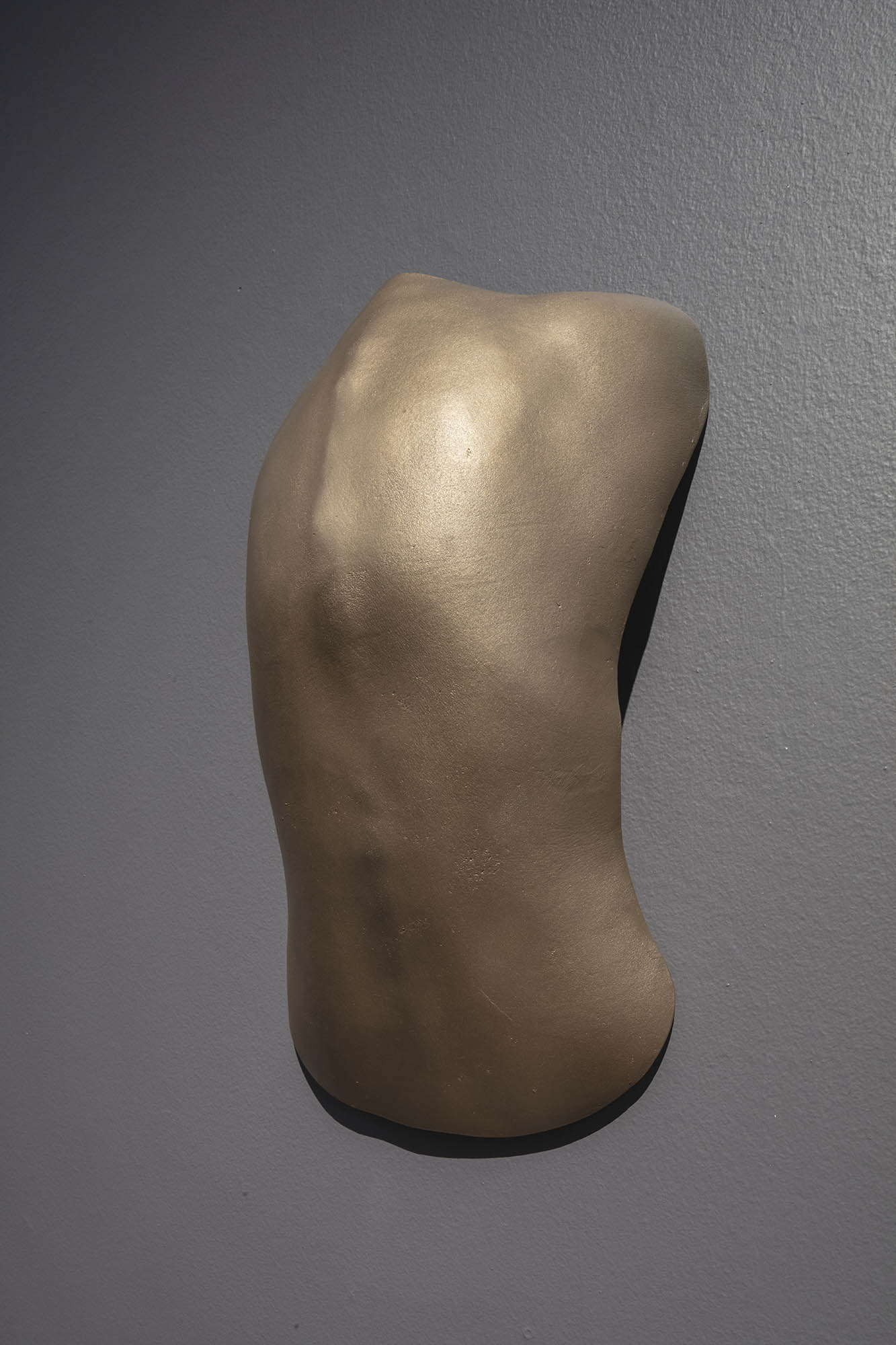 """JULIE RRAP  """"Back to the Wall"""" Shield , 2019  Bronze, edition of 3  59 x 39 x 18 cm"""