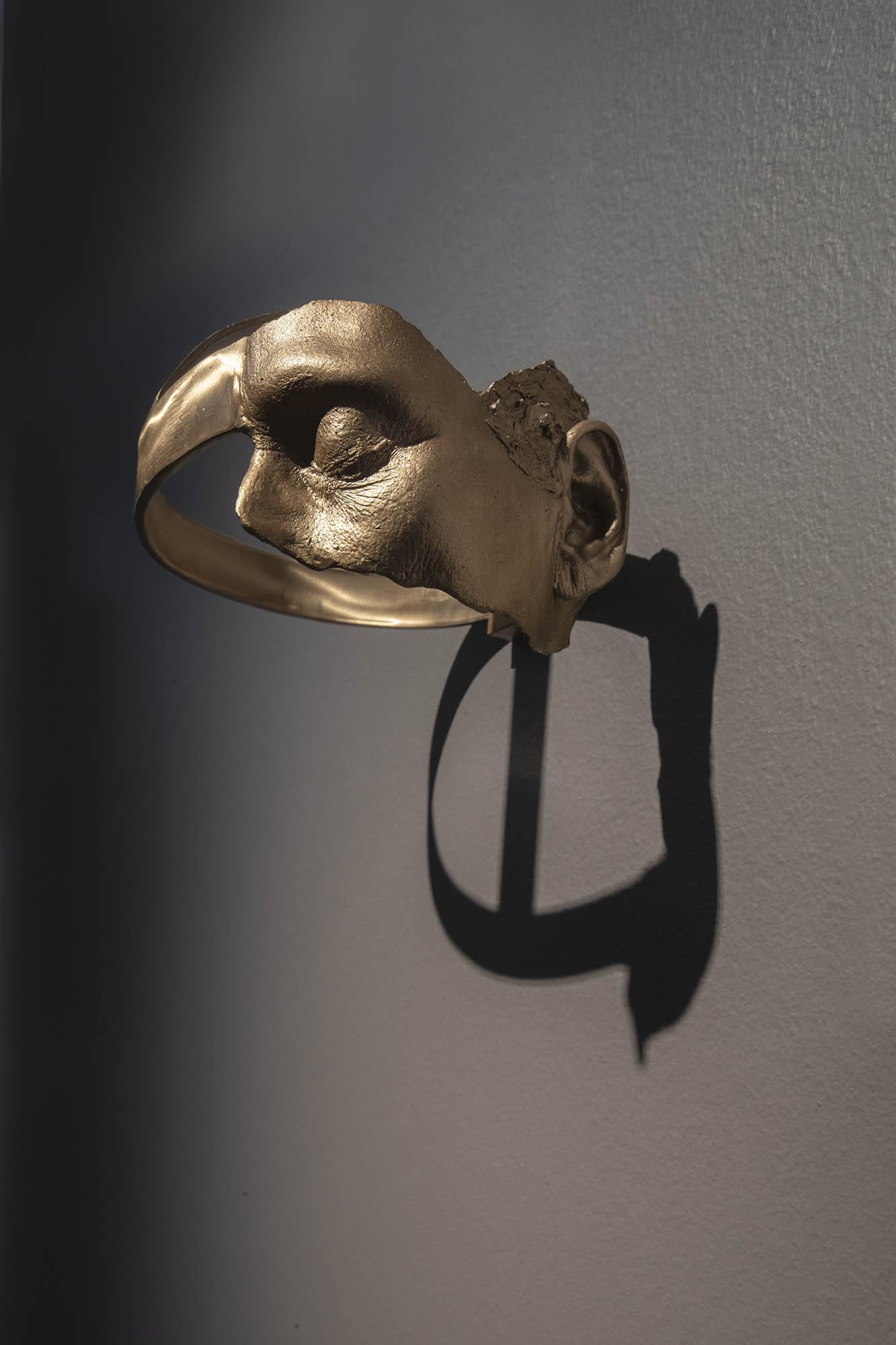 "JULIE RRAP  ""Turning a Blind Eye and Deaf Ear"" Helmet,  2019 Bronze, edition of 3  13 x 20 x 24 cm Photograph by John Gollings"
