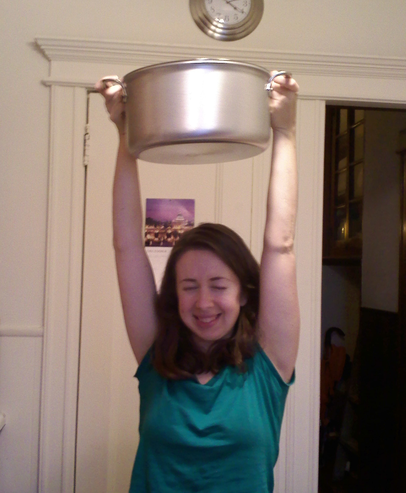 """Me with my first """"real"""" stock pot, an All-Clad stainless steel floor model that Hugo got at Macy's for a steal...this was taken on New Year's Eve 2009. This is a photo of a person who loves making broth, and beautiful cookware! :-)"""
