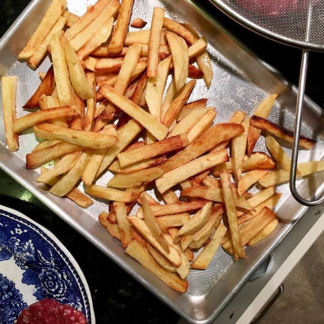 """Figgy looked at me adoringly and said """"these fries are heaven!"""" Made it so worth all the aggravation that went into making them. Organic potatoes hand cut into fries, soaked in water several hours, dried, and cooked in goose fat I rendered from @northwindfarms. Seasoned with Himalayan pink salt. Too bad I'm not eating nightshades.... everyone loved them! #chefhannahspringer #oliverwestonco #goosefatfries #homemadefries #mykidseatwell"""
