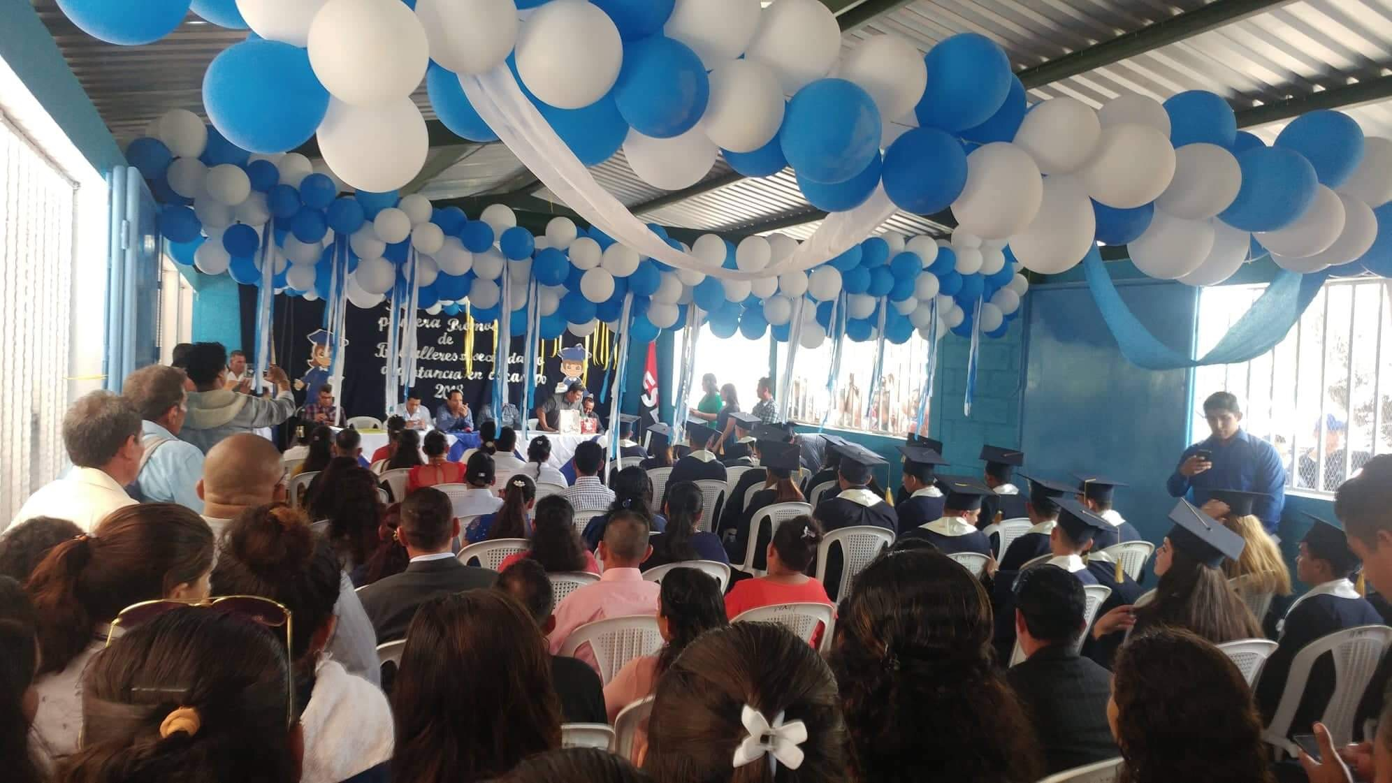 Community members celebrate the 2018 graduating class in the new school at Mesa de Acicaya, Tipitapa Region, Nicaragua