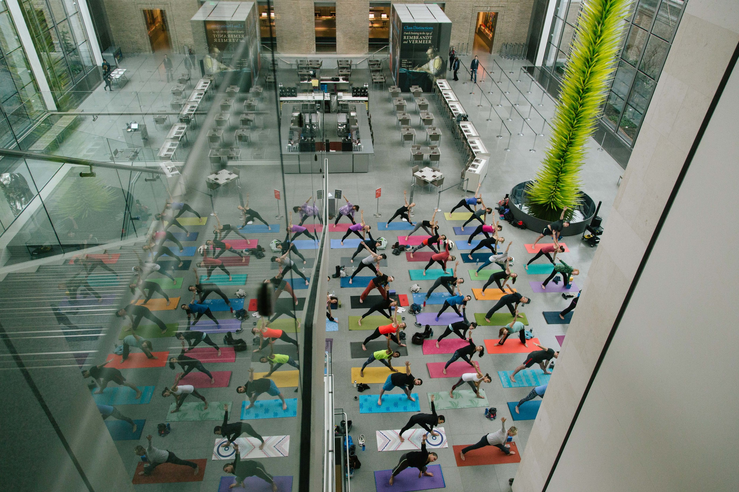 Triangle pose from above as reflected in the staircase at the MFA